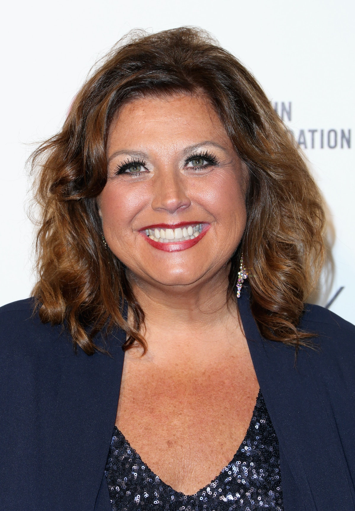 Abby lee miller early photos 4pics 1 word-two blue doors, internet, @mailbox, lady talking to