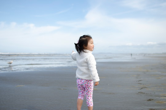 toddler girl at the beach