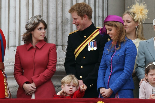 LONDON, ENGLAND - JUNE 16: (L-R)  Princess Eugenie, Prince Harry and Princess Beatrice stand on the balcony of Buckingham Palace after the Trooping the Colour ceremony at the Horse Guards Parade on June 16, 2012 in London, England. The annual ceremony, made up of more than 600 guardsmen and cavalry, is believed to have first been performed during the reign of King Charles II. The parade marked the official birthday of the Sovereign, even though the Queen's actual birthday is on April 21st.  (Photo by Dan Kitwood/Getty Images)