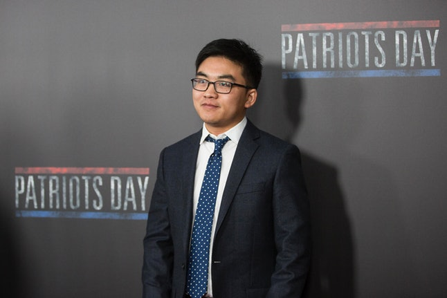 BOSTON, MA - DECEMBER 14:  Carjacking survivor Dun 'Danny' Meng on the red carpet before the Special Boston screening of Patriots Day at Wang Theatre on December 14, 2016 in Boston, Massachusetts.  (Photo by Scott Eisen/Getty Images for Lionsgate)
