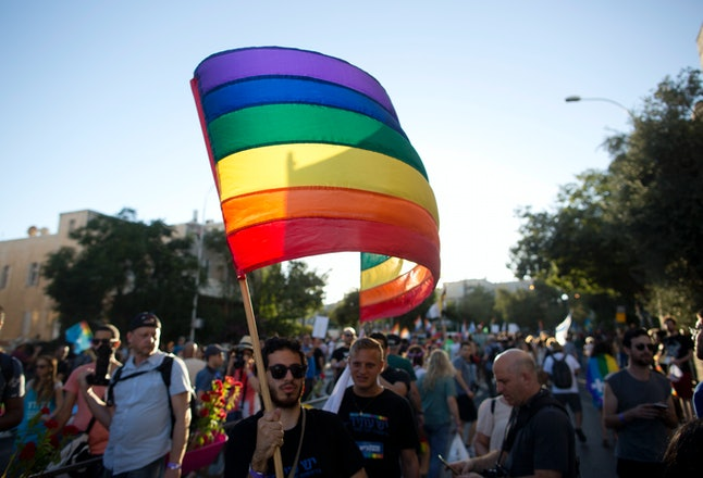 JERUSALEM, ISRAEL - JULY 21:  Israelis take part in the annual Gay Pride parade in Jerusalem on July 21, 2016 in Jerusalem, Israel. Jerusalem's gay pride parade kicked off on Thursday evening under massive security with 25,000 participants and 2,000 police officers on hand in the wake of a murderous rampage by an ultra-Orthodox assailant at last year's parade. (Photo by Lior Mizrahi