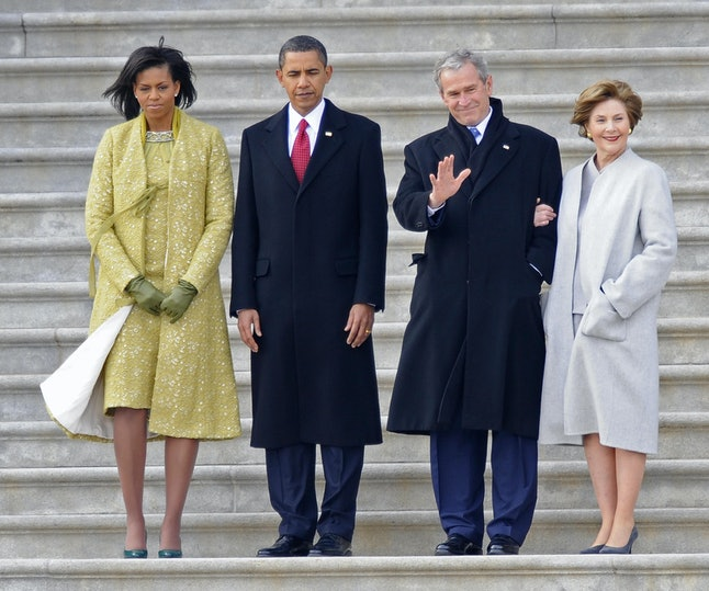 Former US President George W. Bush (2-R) waves as he and his wife Laura (R) stand with US President Barack Obama (2-L) and First Lady Michelle Obama as the Bushes depart from the US Capitol after Obama's swearing in as the 44th President of the United Statesin Washington, DC, 20 January 2009.