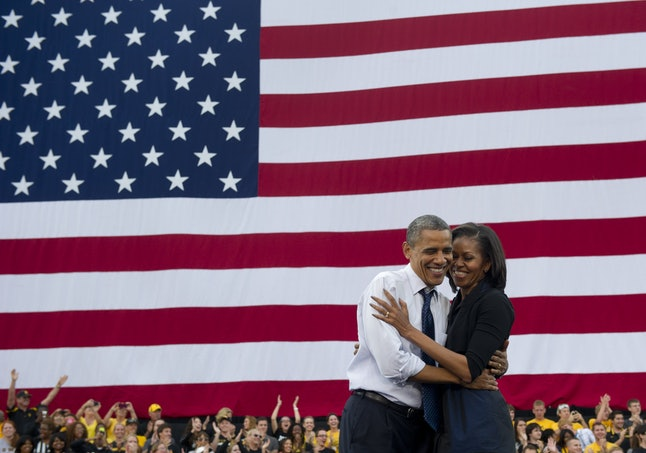 US President Barack Obama embraces First Lady Michelle Obama after speaking during a campaign event at the University of Iowa in Iowa City, Iowa, September 7, 2012.