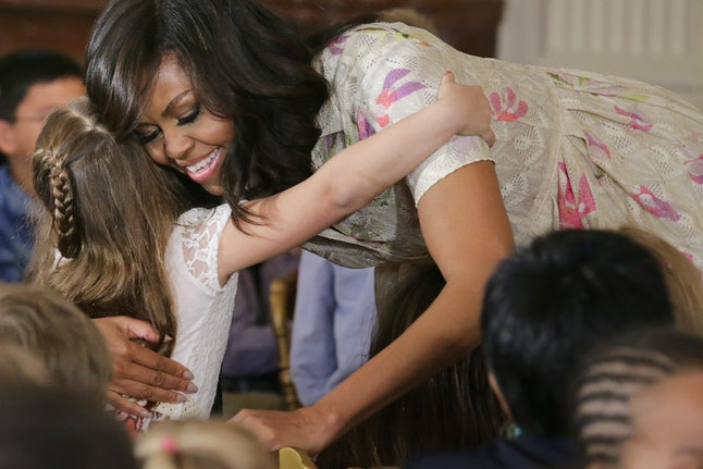 WASHINGTON, DC - APRIL 20:  U.S. first lady Michelle Obama gives hugs to children for Take Our Daughters and Sons to Work Day in the East Room of the White House April 20, 2016 in Washington, DC. The children of Executive Office employees and young people from Big Brothers Big Sisters of America, SchoolTalk and the D.C. Child and Family Services Agency asked Obama questions about her pets, her favorite food (pizza), what she plans to do after leaving the White House and why she chose Barack Obama as her husband. The official observance of the day is April 28.  (Photo by Chip Somodevilla/Getty Images)