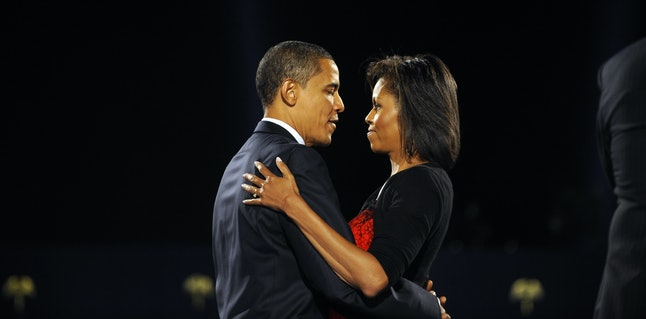 US president-elect Barack Obama and his wife Michelle embrace on stage during Obama's election night victory rally at Grant Park on November 4, 2008 in Chicago, Illinois.  Americans emphatically elected Democrat Obama as their first black president in a transformational election which will reshape US politics and the US role on the world stage.