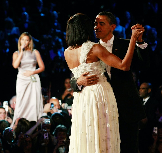 WASHINGTON - JANUARY 20:  US President Barack Obama dances with his wife and First Lady Michelle Obama as Beyonce sings 'At Last' during the first Inaugural Ball on January 20, 2009 in Washington, DC. Obama was sworn in as the 44th President of the United States today, becoming the first African-American to be elected President of the US.  (Photo by Win McNamee/Getty Images)