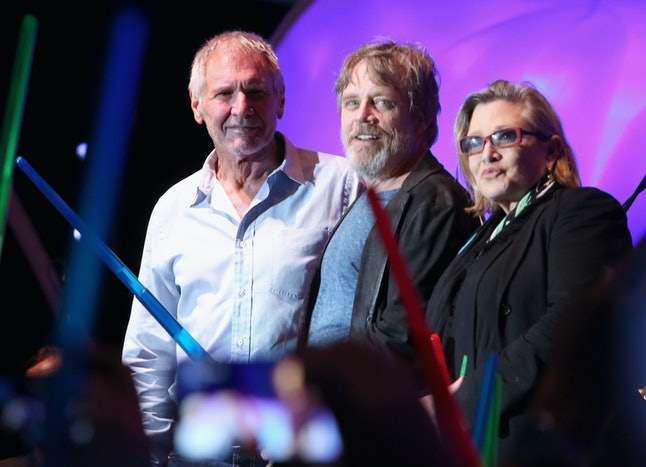 SAN DIEGO, CA - JULY 10:  (L-R) Actors Harrison Ford, Mark Hamill, Carrie Fisher and more than 6000 fans enjoyed a surprise 'Star Wars' Fan Concert performed by the San Diego Symphony, featuring the classic 'Star Wars' music of composer John Williams, at the Embarcadero Marina Park South on July 10, 2015 in San Diego, California.  (Photo by Jesse Grant/Getty Images for Disney)