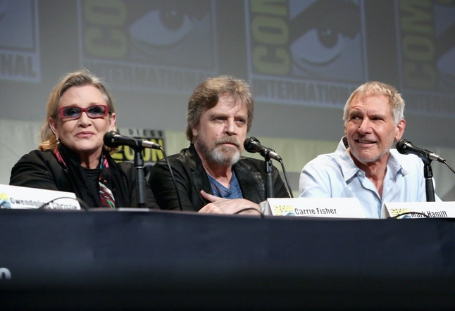 SAN DIEGO, CA - JULY 10:  (L-R) Actors Carrie Fisher, Mark Hamill and Harrison Ford at the Hall H Panel for 'Star Wars: The Force Awakens' during Comic-Con International 2015 at the San Diego Convention Center on July 10, 2015 in San Diego, California.  (Photo by Jesse Grant/Getty Images for Disney)