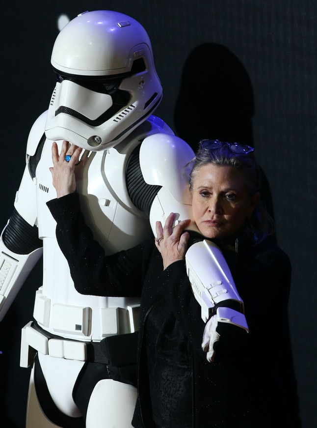 US actress Carrie Fisher attends the opening of the European Premiere of 'Star Wars: The Force Awakens' in central London on December 16, 2015. Ever since 1977, when 'Star Wars' introduced the world to The Force, Jedi knights, Darth Vader, Wookiees and clever droids R2-D2 and C3PO, the sci-fi saga has built a devoted global fan base that spans the generations.