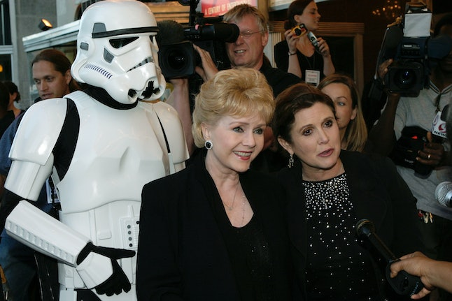 WASHINGTON - MAY 12:  Actresses Debbie Reynolds (L) and Carrie Fisher (R) arrive at the premiere of 'Star Wars Episode III: Revenge of the Sith,' at the Loews Cineplex Uptown Theatre May 12, 2005 in Washington, DC. Star Wars premiers are taking place across the country tonight.  (Photo by Shaun Heasley/Getty Images)