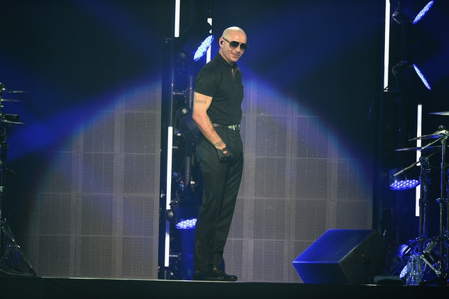 MIAMI, FL - NOVEMBER 05:  Pitbull performs on stage at iHeartRadio Fiesta Latina at American Airlines Arena on November 5, 2016 in Miami, Florida.  (Photo by Jason Koerner/Getty Images for iHeartMedia)