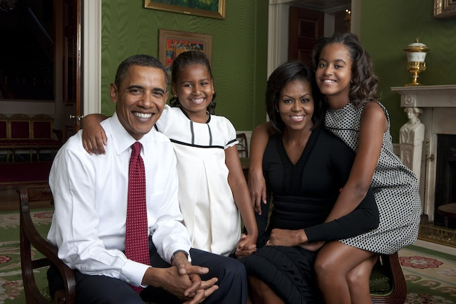 WASHINGTON - SEPTEMBER 1:  In this handout form the White House, (L to R) U.S. President Barack Obama, daughter Malia Obama, first lady Michelle Obama and daughter Sasha Obama sit for portrait in the Green Room of the White House September 1, 2009 in Washington, DC.  (Photo by Annie Leibovitz/White House via Getty Images)