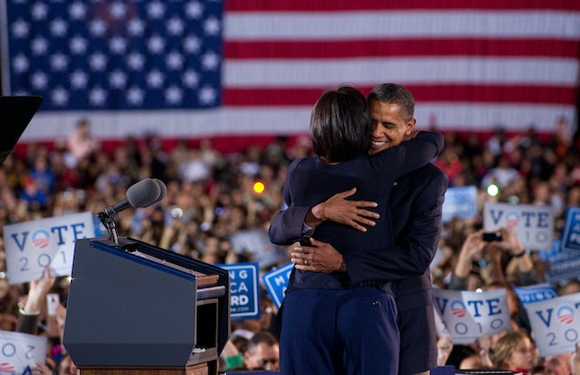 US President Barack Obama embraces First Lady Michelle Obama prior to speaking during a rally for the Democratic National Committee at Ohio State University in Columbus, Ohio, October 17, 2010.