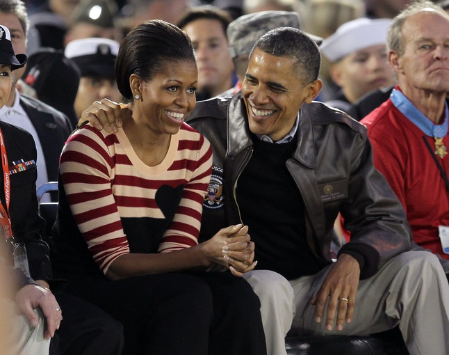 CORONADO, CA - NOVEMBER 11:  President Barack Obama and first lady Michelle Obama speak to one another during the NCAA men's college basketball Carrier Classic between the Michigan State Spartans and the North Carolina Tar Heels aboard the flight deck of the USS Carl Vinson on November 11, 2011 in San Diego, California.  (Photo by Ezra Shaw/Getty Images)