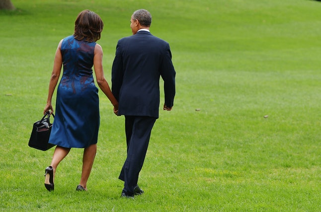 US President Barack Obama and First Lady Michelle Obama make their way to board Marine One on the South Lawn of the White House on September 23, 2013 in Washington, DC. Obama was headed to New York City to attend the United Nations General Assembly.