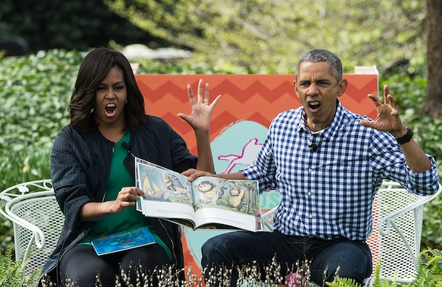 US President Barack Obama and First Lady Michelle Obama read Maurice Sendak's 'Where the Wild Things Are' to children at the annual Easter Egg Roll at the White House in Washington, DC, on March 28, 2016. Some 35,000 guests have been invited to participate in the 138th annual Easter Egg roll. The theme of the day's event is Let's Celebrate!