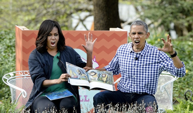 WASHINGTON, DC - MARCH 28: (AFP OUT)  President Barack Obama (R) and first lady Michelle Obama (L) imitate monsters as they read 'Where the wild things are'during the White House Easter Egg Roll on the South Lawn of the White House March 28, 2016 in Washington, DC. The tradition dates back to 1878 when President Rutherford B. Hayes allowed children to roll eggs on the South Lawn. (Photo by Olivier Douliery-Pool/Getty Images)