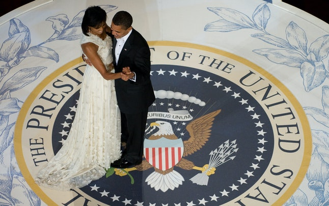US President Barack Obama and First Lady Michelle Obama dance during the Commander-in-Chief Ball at the National Building Museum in Washington, DC, January 20, 2009. Obama was sworn in as the 44th US president earlier in the day.
