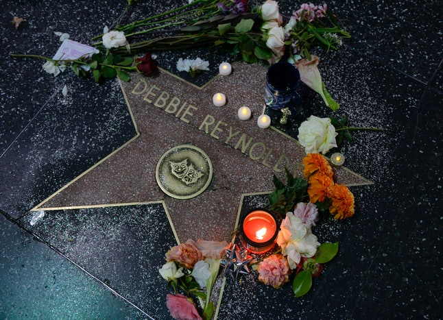 HOLLYWOOD, CA - DECEMBER 29: Flowers are placed Debbie Reynolds's live performance star on The Hollywood Walk of Fame on December 29, 2016 in Hollywood, California. Reynolds has two stars on The Hollywood Walk of Fame, one for live performance and another for film performance. (Photo by Kevork Djansezian/Getty Images)
