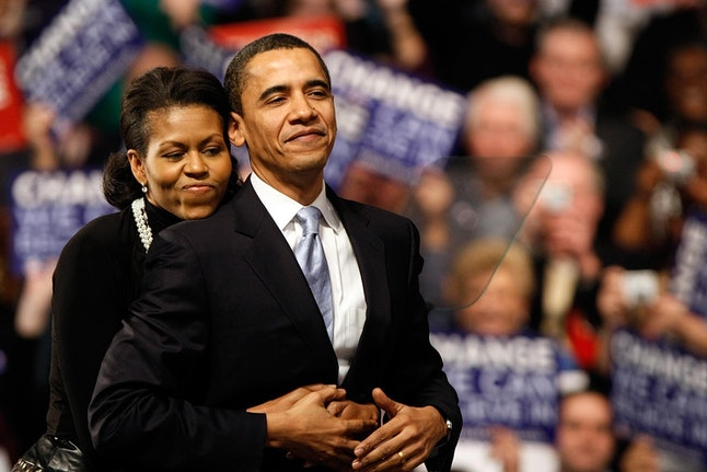 NASHUA, NH - JANUARY 08:  Democratic presidential hopeful Sen. Barack Obama (D-IL) is hugged by his wife Michelle Obama before his speech at a primary night rally in the gymnasium at the Nashua South High School on January 8, 2008 in Nashua, New Hampshire. Obama finished a projected 2nd place behind Sen. Hillary Clinton (D-NY) in the nation's first democratic primary  (Photo by Win McNamee/Getty Images)