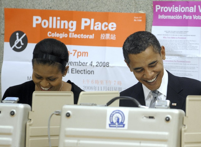 US Democratic presidential candidate Illinois Senator Barack Obama casts his vote in the 2008 presidential elections with wife Michelle (L) in Chicago, Illinois, November 4, 2008.