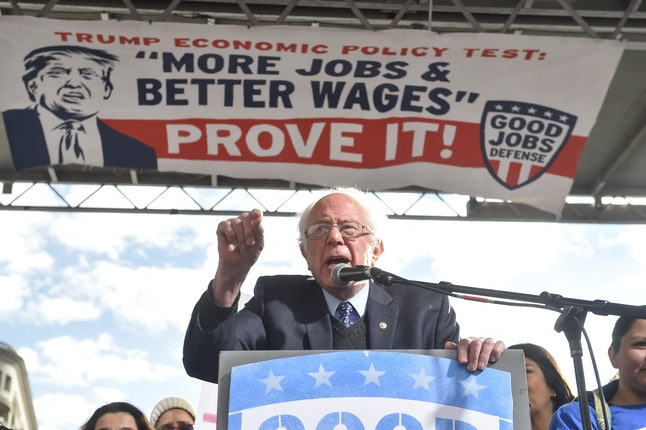 US Senator from Vermont Bernie Sanders speaks at a rally of striking federal contract workers calling on President-elect Donald Trump to stop federal contractors from shipping jobs overseas and stealing the pay of workers in the US in Washington, DC, on December 7, 2016.