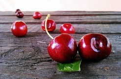 cherries sitting on a surface