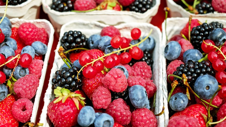 Containers of strawberries, blueberries, and raspberries