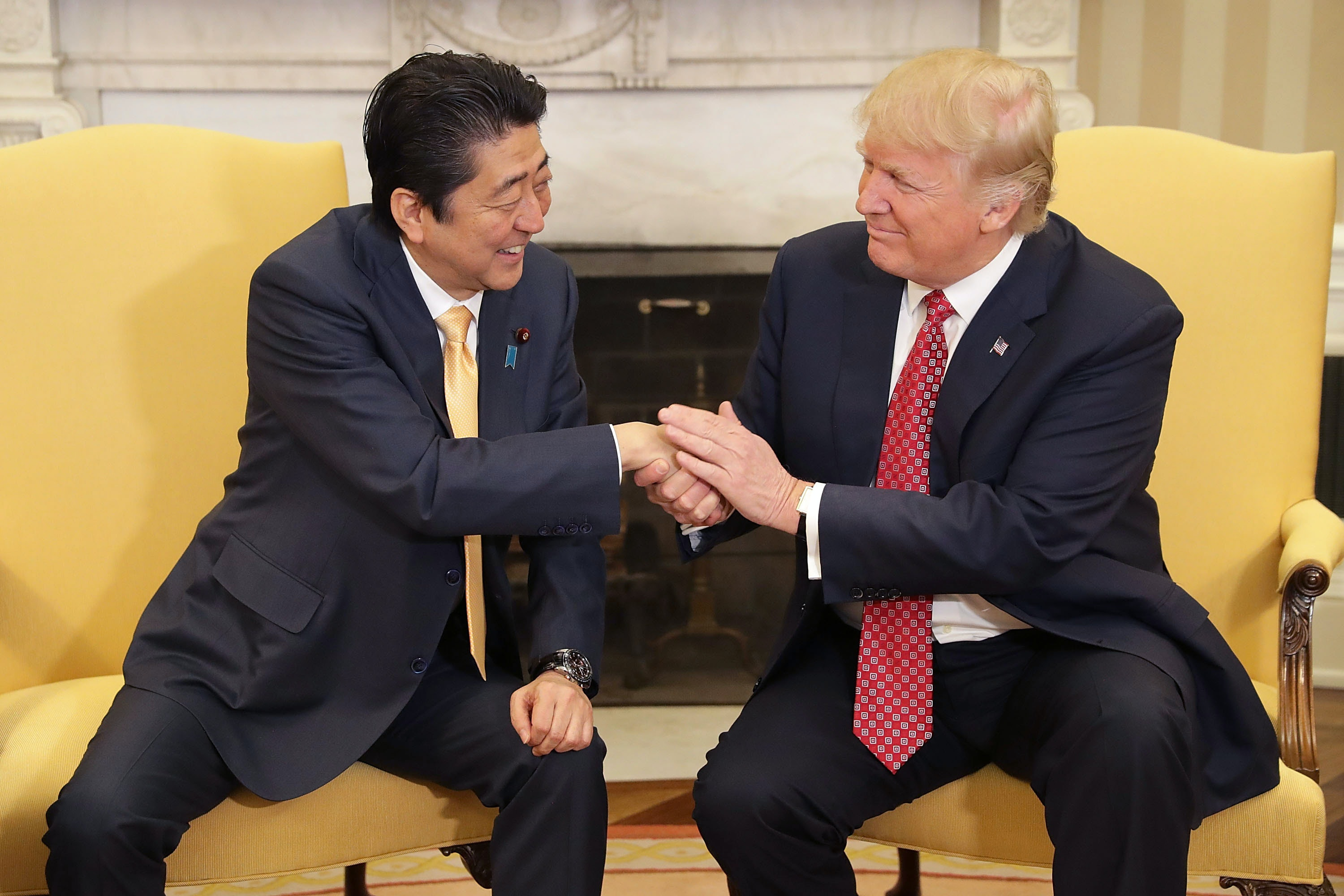 Shinzo Abes Facial Expression After Shaking Hands With Trump Will