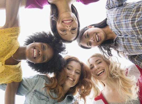 circle of women looking down at camera