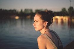 sad woman looking at river