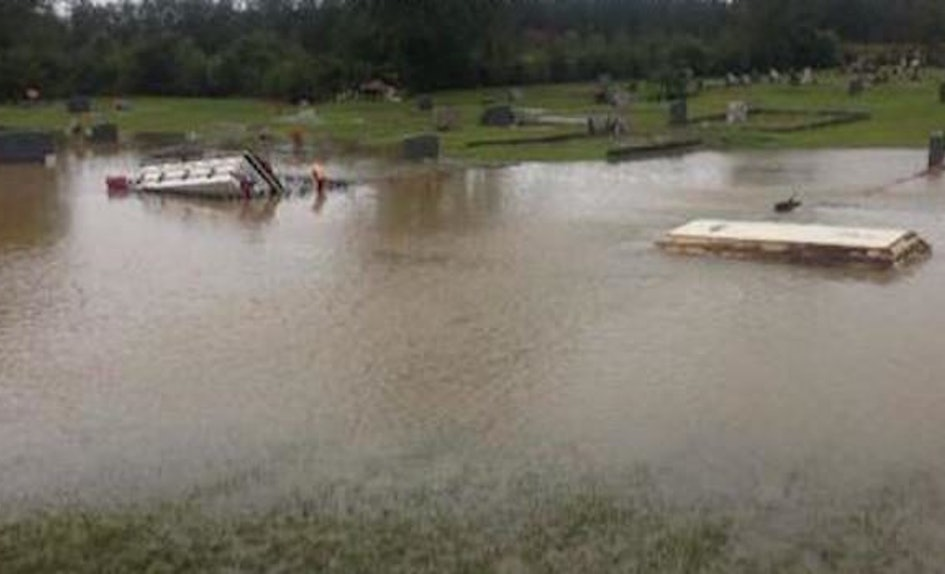 record breaking flooding is causing coffins to come out of the ground