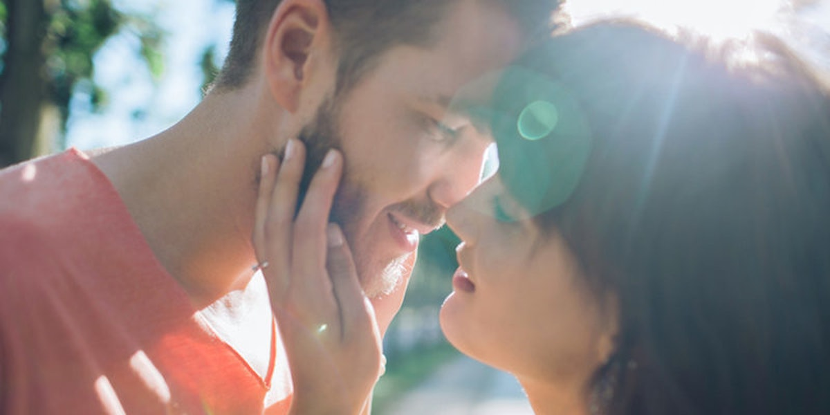 A girl knows her partner is crazy about her and kisses him on the lips.
