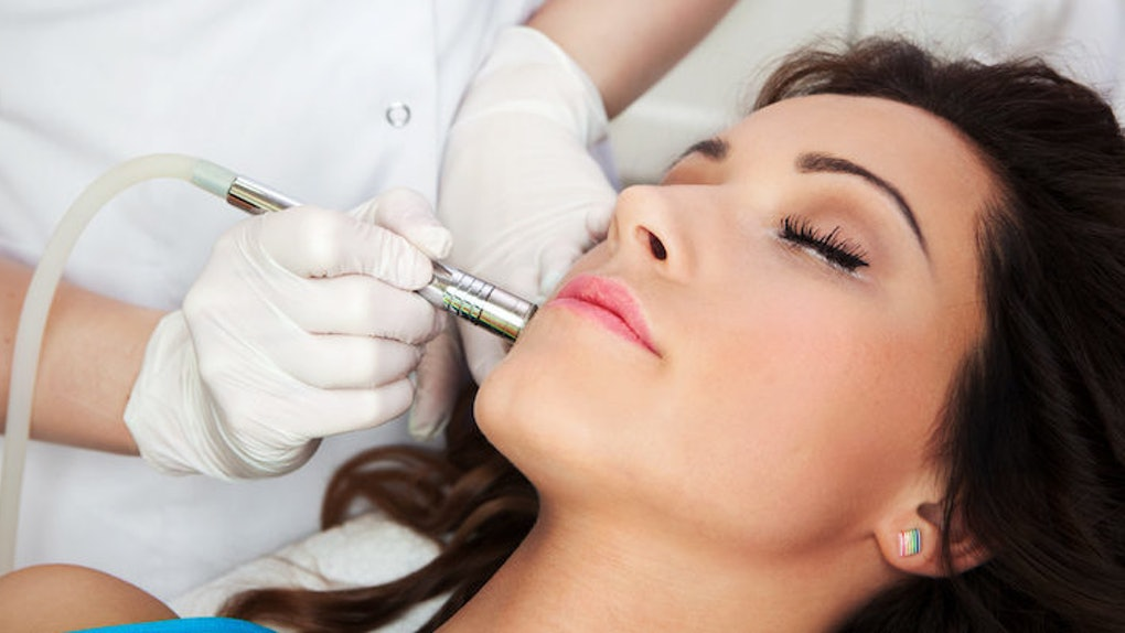 How Laser Treatments Can Cure Adult Acne, As Told By A Dermatologist