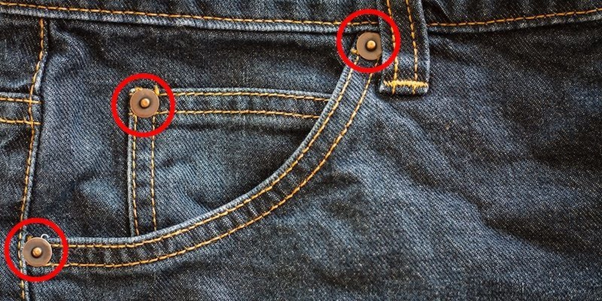 This Is The Reason Your Jean Pockets Have Tiny Buttons On Them