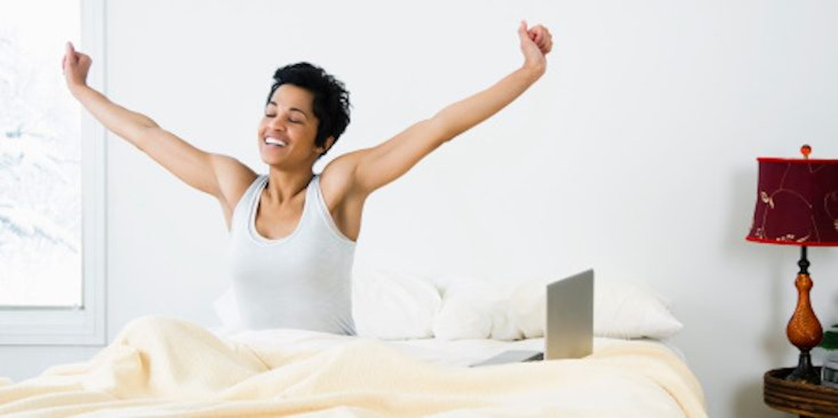 8 Morning Stretches To Wake You Up From The Moment You Roll Out Of Bed