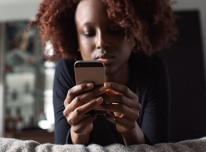 A woman stares at her phone. Here's what it means if your partner is texting you less often.