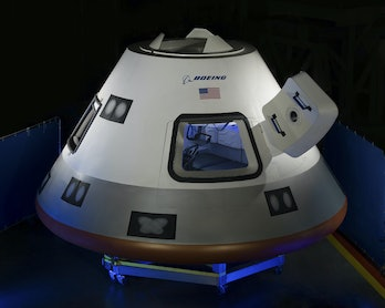 Boeing unveils a mockup of its CST-100 Starliner in July 2013 at theHouston Product Support Center in Texas. Six years after this design was unveiled, it still has yet to fly any humans.