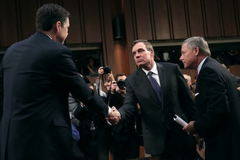WASHINGTON, DC - JUNE 08: Former FBI Director James Comey (L) is greeted by Senate Intelligence Committee Chairman Richard Burr (R-NC) (R) and ranking member Sen. Mark Warner (D-VA) before a hearing in the Hart Senate Office Building on Capitol Hill June 8,2017in Washington, DC. Comey said that President Donald Trump pressured him to drop the FBI's investigation into former National Security Advisor Michael Flynn and demanded Comey's loyalty during the one-on-one meetings he had withpresident. (Photo by Drew Angerer/Getty Images)