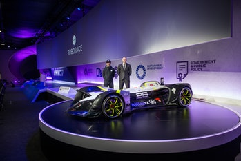 Denis Sverdlov, Roborace CEO, and Daniel Simon, Roborace chief design officer, stand next to the Robocar.