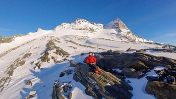 In this photo posted on his Flickr account, Kocher appears at work flying his drone in the mountains...