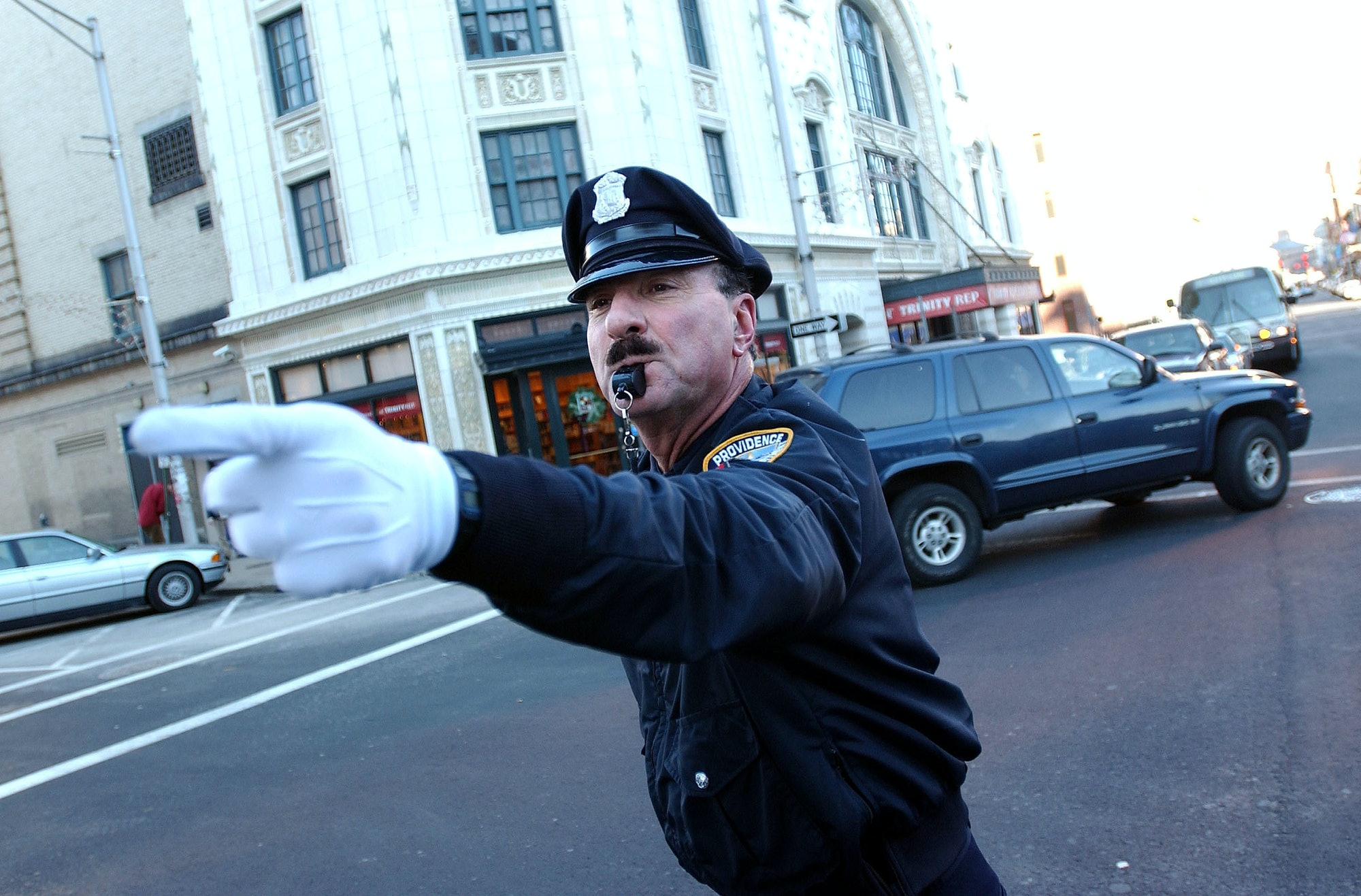 PROVIDENCE, RI - DECEMBER 14: Retired police officer Tony Lepore performs his dance routine while directing traffic December 14,2004in downtown Providence, Rhode Island. Lepore has been entertaining drivers and directing traffic at intersections around Providence for 20 years. He came upon the idea after seeing a 'Candid Camera' clip of New York City police officers who flamboyantly directed traffic in the 1950's. (Photo by Darren McCollester/Getty Images)