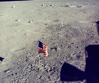 America flag and camera on the surface of the Moon