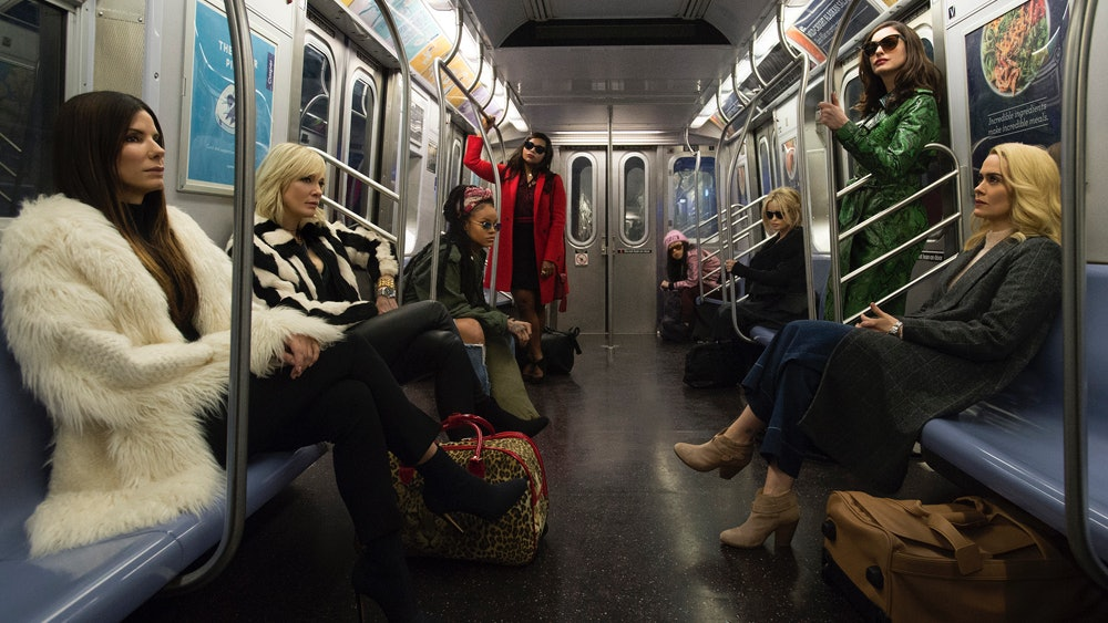 Here's the full team assembled on a New York City subway car.