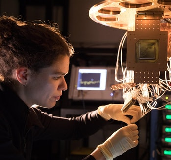 A Bristlecone chip being installed by Research Scientist Marissa Giustina at the Quantum AI Lab in Santa Barbara