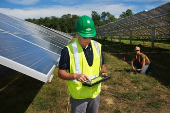 Worker maintaining solar panels of Long Island Solar Farm