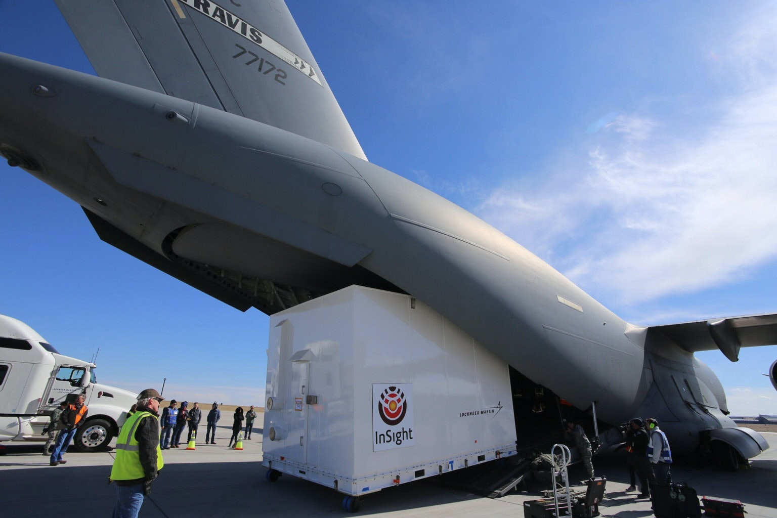 Personnel supporting NASA's InSight mission to Mars load the crated InSight spacecraft into a C-17 cargo aircraft at Buckley Air Force Base, Denver, for shipment to Vandenberg Air Force Base, California.