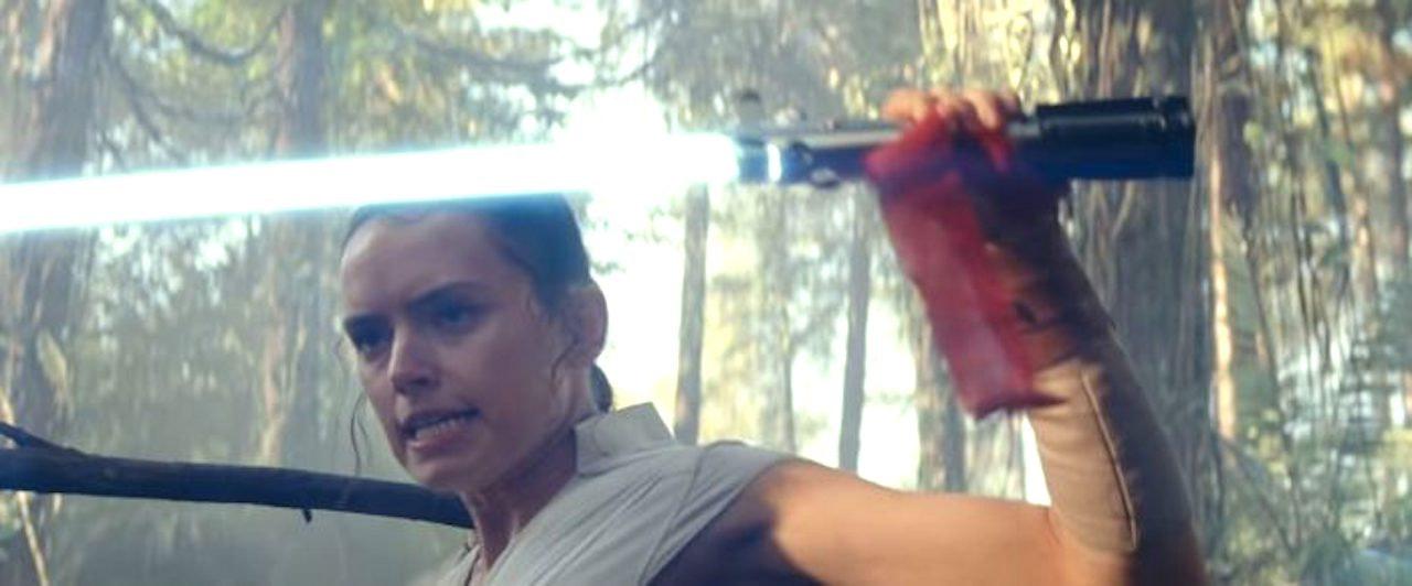 Rey with the Skywalker lightsaber in the D23 'Rise of Skywalker' trailer
