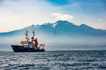 Research Vessel Poseidon deploys transponders across the seafloor at Mount Etna's flank to detect ch...