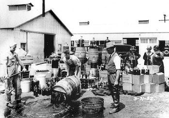 Orange County Sheriff's deputies dump illegal booze in Santa Ana, Calif. in this 1932 photograph.